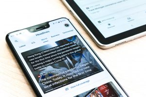 solar companies on the news on a iPhone screen